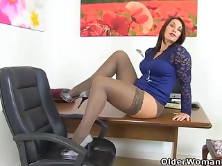 Dark haired, Brit cougar is fuckin' her cunt with a ebony magic wand, in her tryst