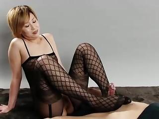 Blond girl in ebony tights is providing a footjob nearby a stud she enjoys a plenty be useful to