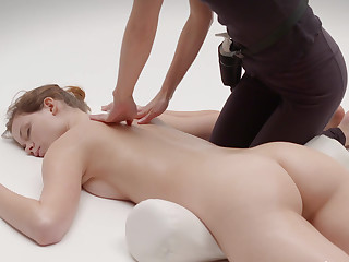 Sustenance blonde massaged at the end of one's tether a masseuse