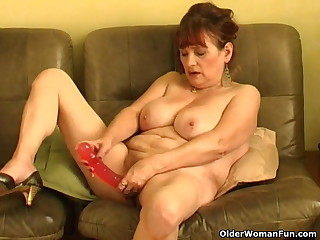 Old granny with big tits pushing dildo up say no to pussy