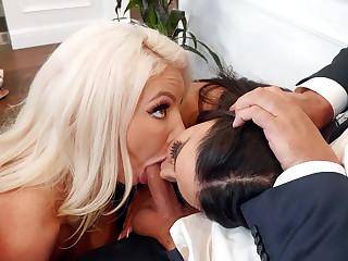 Lela Star and Nicolette Shea suck cock and lick balls