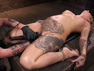 Tattooed porn model Kleio Valentien gets punished in put emphasize dark BDSM room