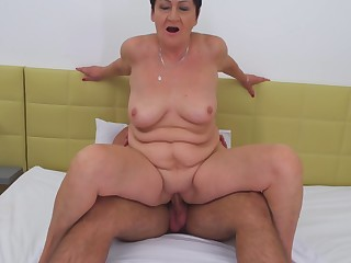 Short haired amateur mature brunette Karina W. pounded doggy style