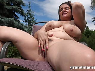Horny milf masturbates in the garden thinking about permanent penis