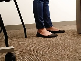 A Be published At An Office Managers Well Worn Black Ballet Flats