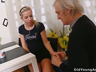 Unreservedly slim blonde bitch Nelya is seduced wide of fucked wide of elder statesman man