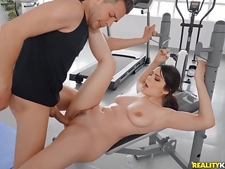 Busty prostitute Valentina Nappi gets oiled and fucked in the gym