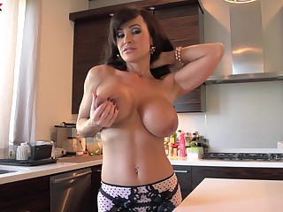 Cougar pornstar Lisa Ann with large fake boobs fucked by a timber