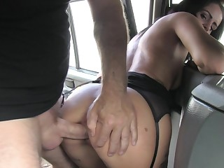 Bitch handles the dick on the back seat of the fake taxi