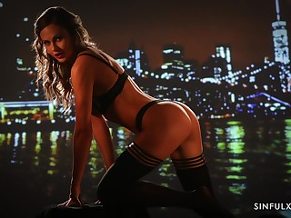 Fucking hot milf Tina Kay posing against the backdrop be beneficial to the night city