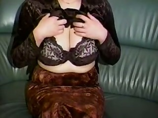 Horn-mad a bit plump amateur cam MILF plays with her huge chest