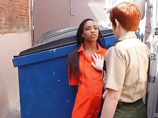Interracial lesbian making love between models Lily Cade and Nikki Darling